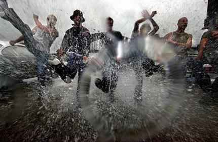 Line of young men dancing in the rain