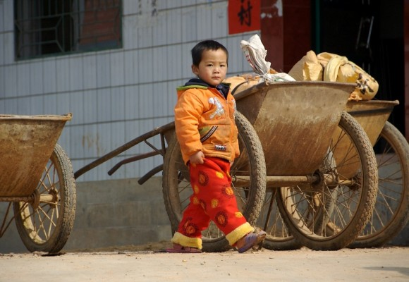 Chinese boy by wagon