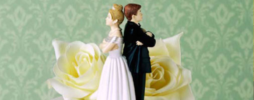 Bride and Groom back to back on wedding cake
