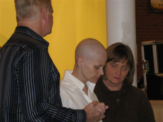 Amy being baptised by Gary and Belinda