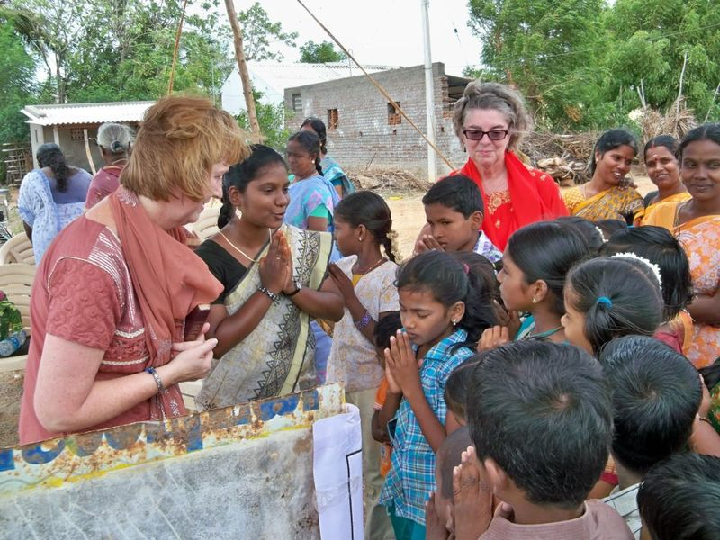 Nancy praying for the children of this village