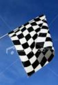 Checkered_flag_at_the_finish_line